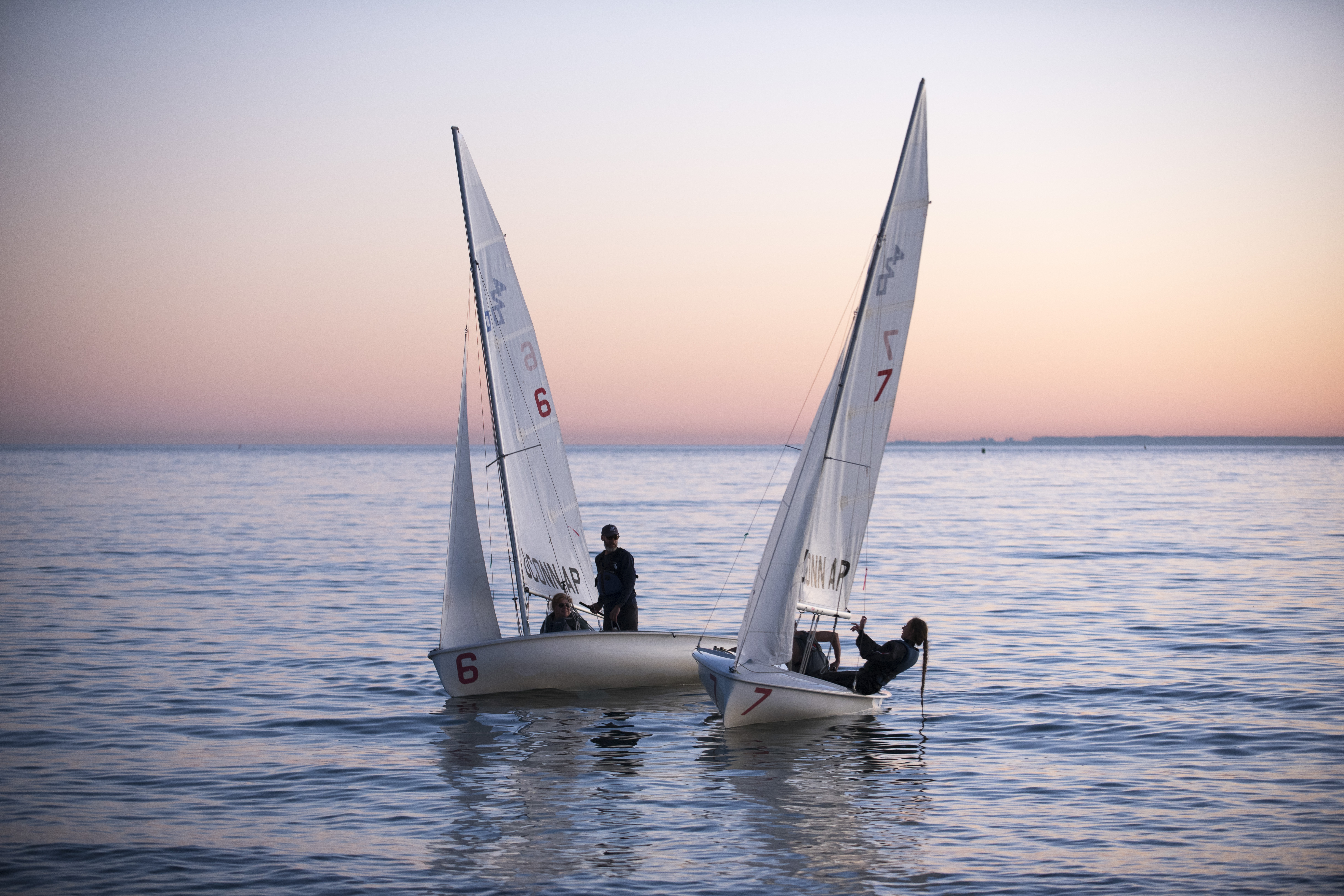 The UConn sailing club sailing in Long Island Sound during sunset at the Avery Point campus on Nov. 18, 2016. (Sean Flynn/UConn Photo)