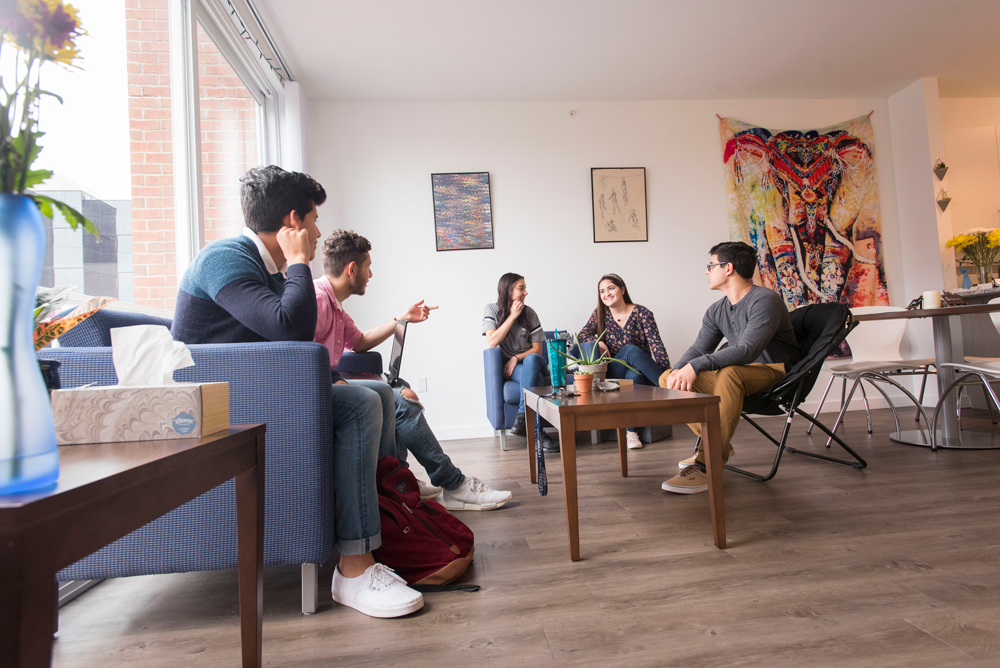 Students socializing (hanging out) in their apartment